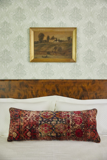 primary-bedroom-bed-detail-hanging-wall-art
