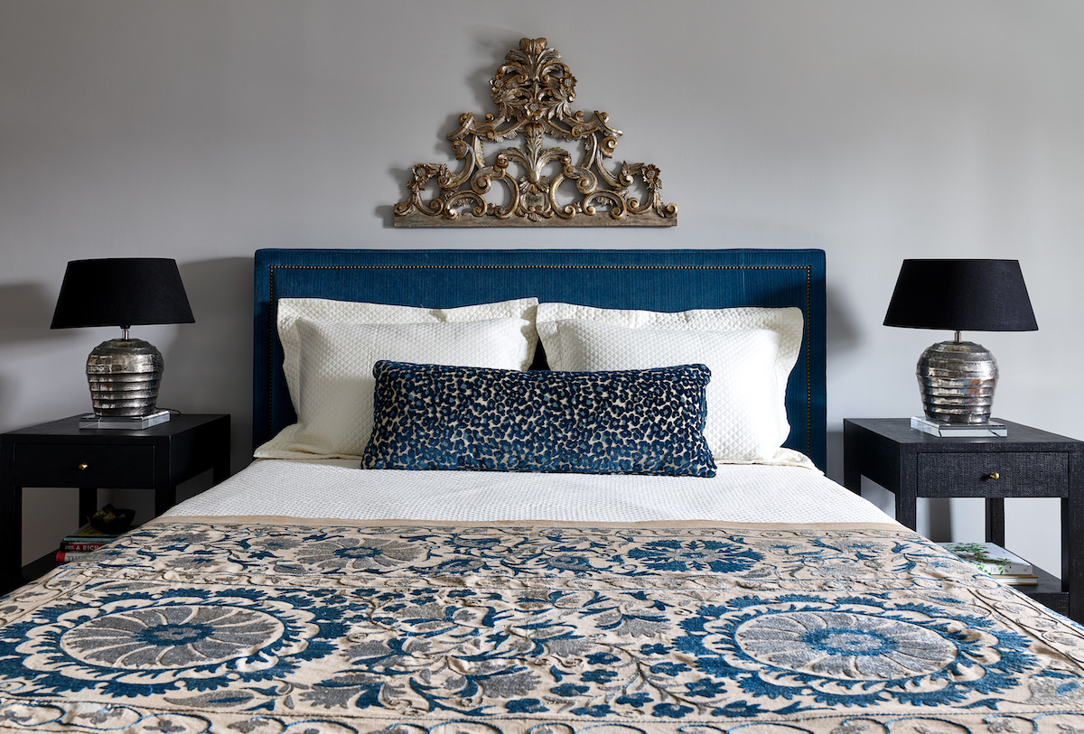 primary-bedroom-bed-fabric-headboard-accent-pillows